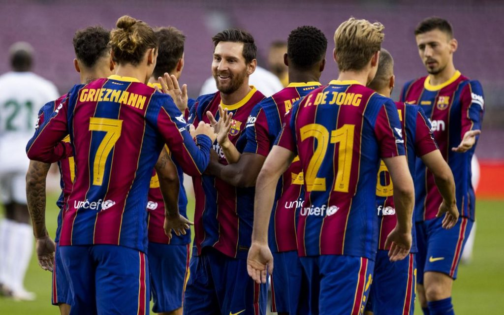 Messi celebrating with his Barcelona teammates